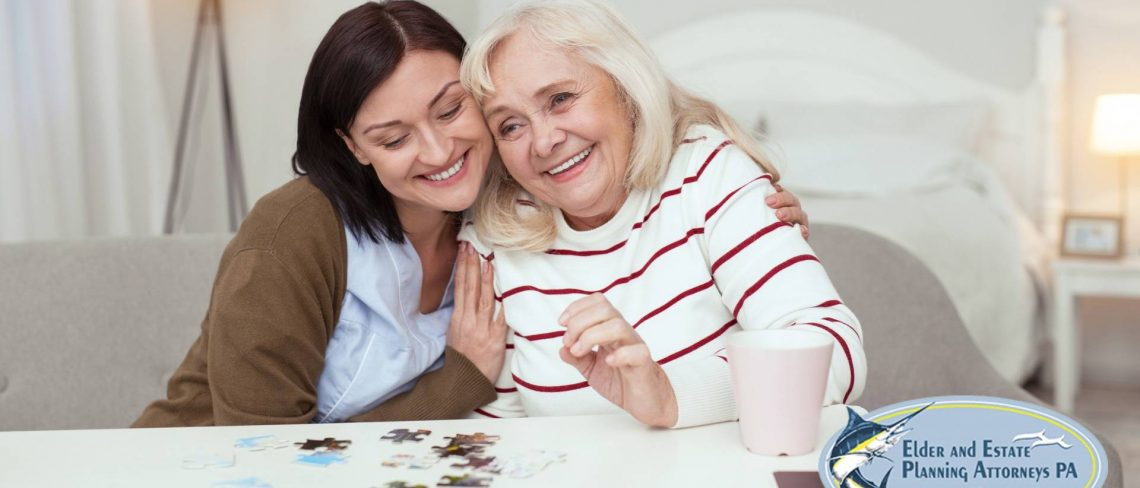 elder care attorney - Young woman and mature woman embrace joyfully while playing puzzles