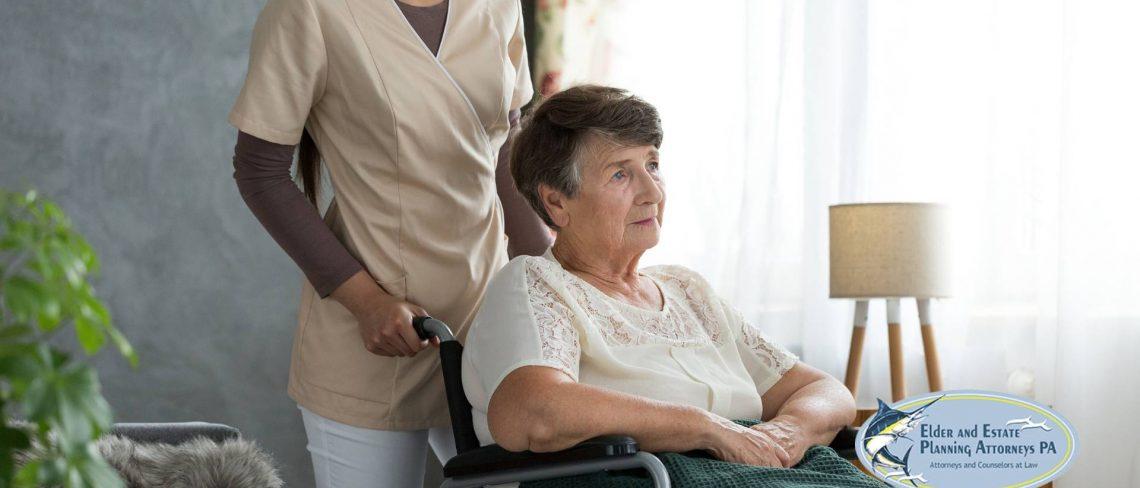 Young nurse pushing an elderly woman in a wheelchair