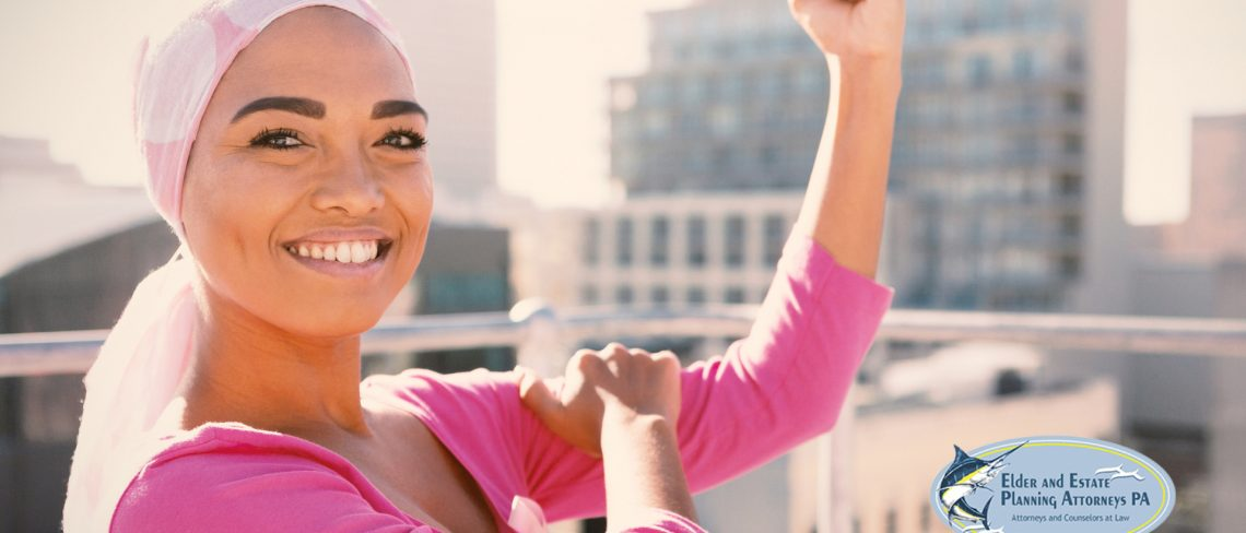 African-American woman in pink scarf - breast cancer resources for senior women and loved ones