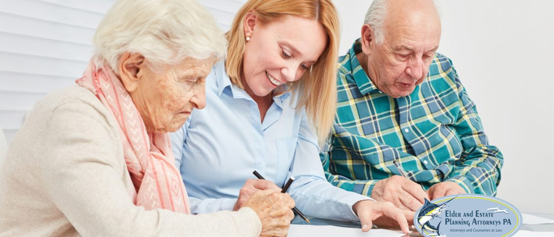 Estate planning attorney with elderly couple reviewing legal documents