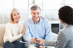 Estate Planning - Photo of a Happy Mature Couple planning their estate.