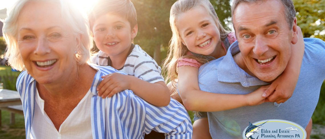 estate planning lawyer - mature, happy couple grand kids. estate plan