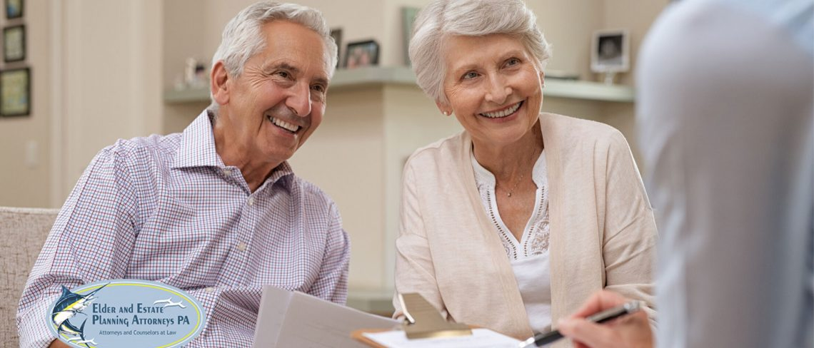 Elder Lawyers - Mature couple reviews legal documents with attorney.